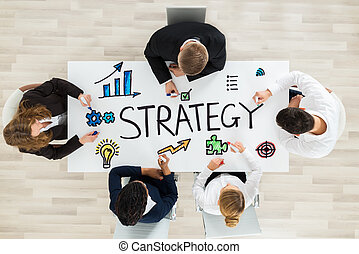 Businesspeople Drawing Strategy Diagram
