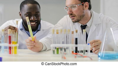 Team Of Researchers Doctors In Laboratory, Male Scietists...