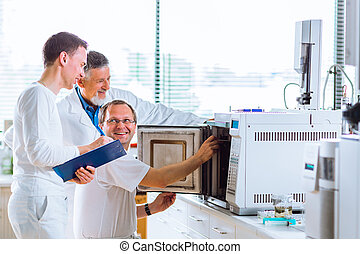 Team of researchers  in a lab