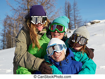 Team of snowboarders - Portrait of four young people in ski...