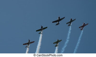 Team of stunt planes in the sky