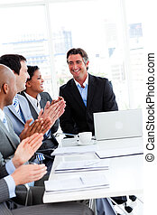Team of successful business people clapping