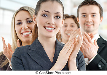 team of successful smiling young business people