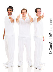 team of three men giving thumbs up