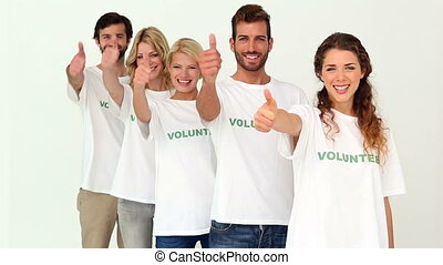 Team of volunteers giving thumbs up