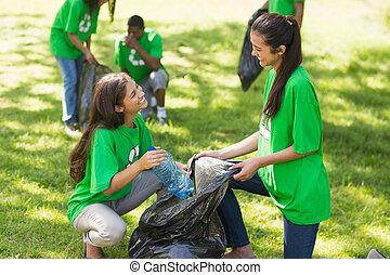 Team of volunteers picking up litte