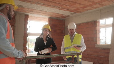Team Of Workers In Construction Site Meeting Inside New Building