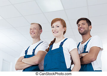 Team of young cleaners