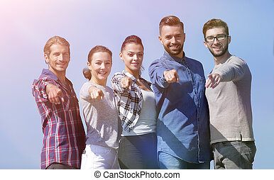 team of young people showing hands forward