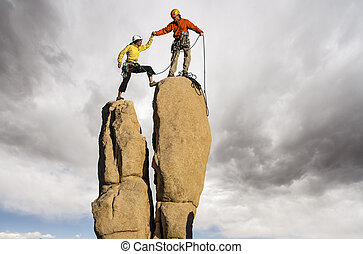 Team on the summit. - Team of climbers struggle to the...