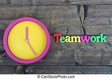 Team on wooden table
