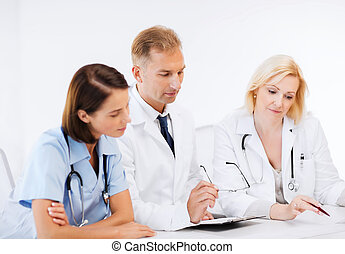 team or group of doctors on meeting