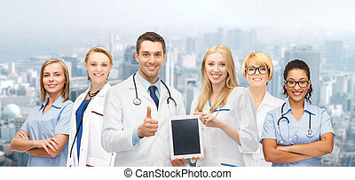 team or group of doctors with tablet pc computer - medicine,...