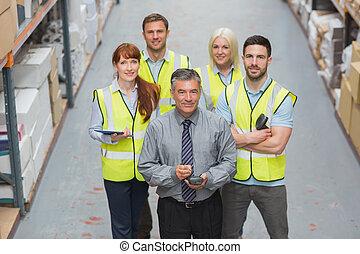 Team standing behind their boss