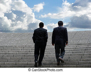 Team to success - Two business men walking up the stairs