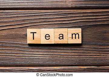 team word written on wood block. team text on wooden table for your desing, concept