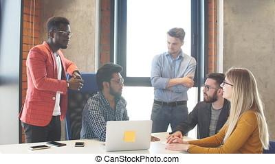 Team work at interantional corporation modern office -...