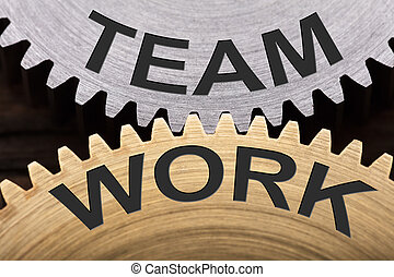 Team Work Concept On Interlocked Cogwheels - Closeup of team...