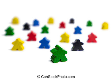 Team work. Leadership in a group of people. Colorful game figures.