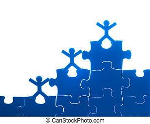 Team work on solving puzzle problem. Team work concept.