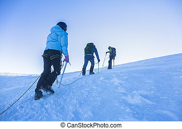 Team work on the top in French Alps