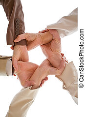 Team Work - Small group of business people joining hands, ...