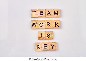 Team work words made with alphabet blocks.