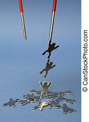 Magnet Lifting Metal Figures onblue background