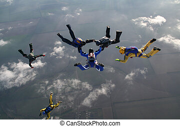 Teambuilding - The group of parachutists in air