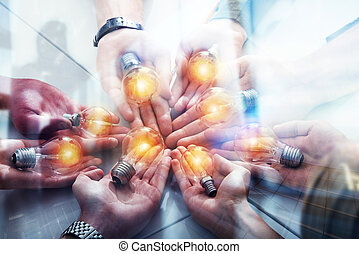 Teamwork and brainstorming concept with businessmen that share an idea with a lamp. Concept company startup. Double exposure
