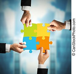 Teamwork and partnership concept - Businessman with puzzle....