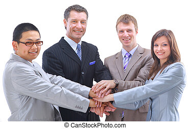Teamwork and team spirit - Hands piled on top of one another with a multi-ethnic group in the background