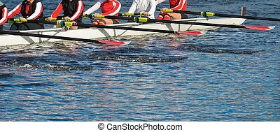 Teamwork: Close-up of rowers - Close-up panoramic photo of a...