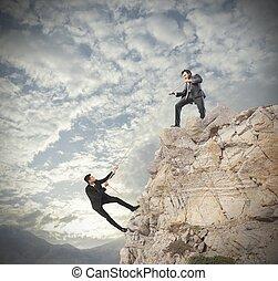 Teamwork concept - Concept of teamwork with climbing...