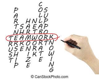 teamwork concept crossword written by man's hand