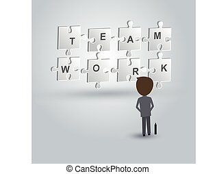 Teamwork concept of businessman looking to the jigsaw puzzle