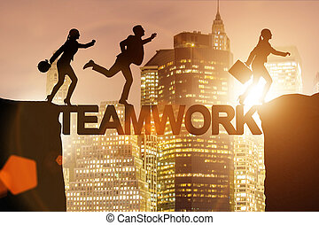 Teamwork concept with business people crossing bridge