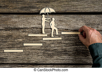 Teamwork concept with cut outs of two men - Insurance...