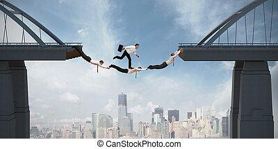 Teamwork concept with running businessman over the bridge