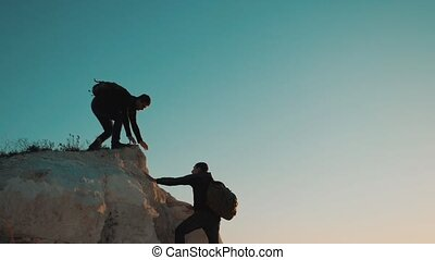 Teamwork friendship hiking help each other trust assistance...