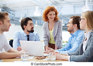 Teamwork - Group of business partners sharing ideas upon...