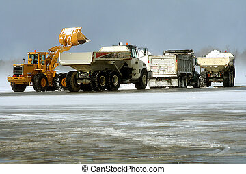 Teamwork - Heavy equipment removing snow from airport