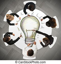 Teamwork idea - Teamwork draws a big idea during a meeting
