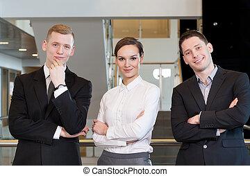 Teamwork in business centre - Teamwork before work in...
