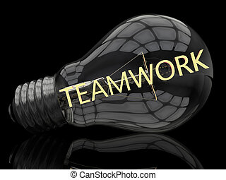 Teamwork - lightbulb on black background with text in it. 3d...