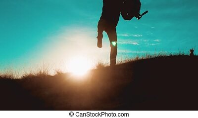 teamwork men run jump from happiness victory walking . two tourists hikers men with backpacks at sunset go hiking trip overcoming difficulties victory success. hikers adventure and the dog go walking. travel mountains silhouette. hikers lifestyle adventure and the dog go
