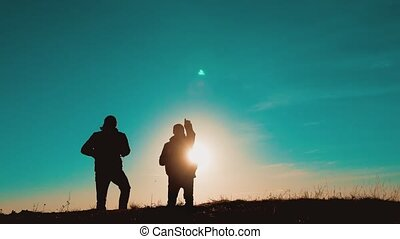 teamwork men smartphone navigation. two tourists hikers men...