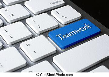 Teamwork  on white keyboard
