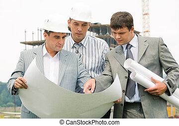 Teamwork - Image of three businessmen looking at...