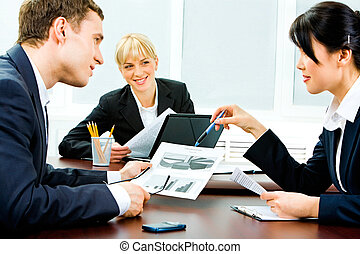 Teamwork - Portrait of business partners holding business...